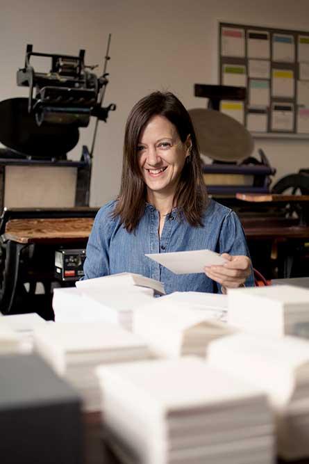 Breck sorting stacks in her Brooklyn Studio