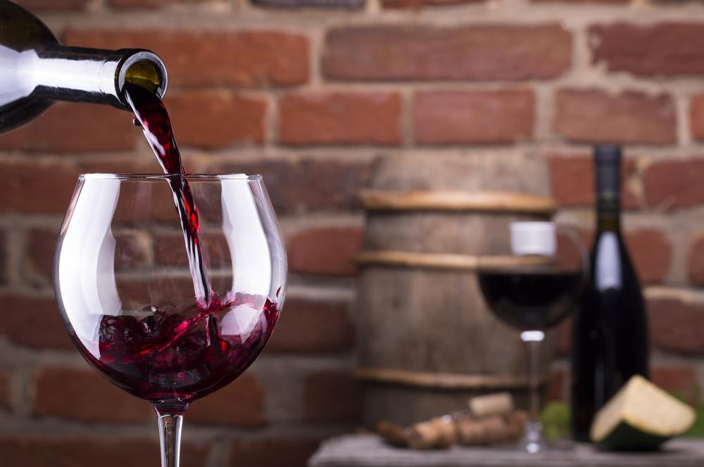 bigstock-Glass-Of-Wine-Against-A-Brick--46934482.jpg