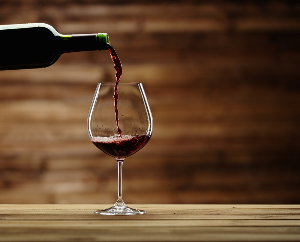 bigstock-Pouring-red-wine-into-the-glas-64905025.jpg