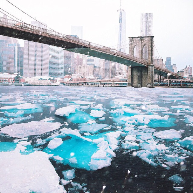 Ice Floats Under Brooklyn Bridge