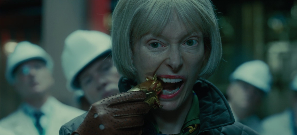 tilda-swinton-evaluates-the-proposed-deal-in-okja.png