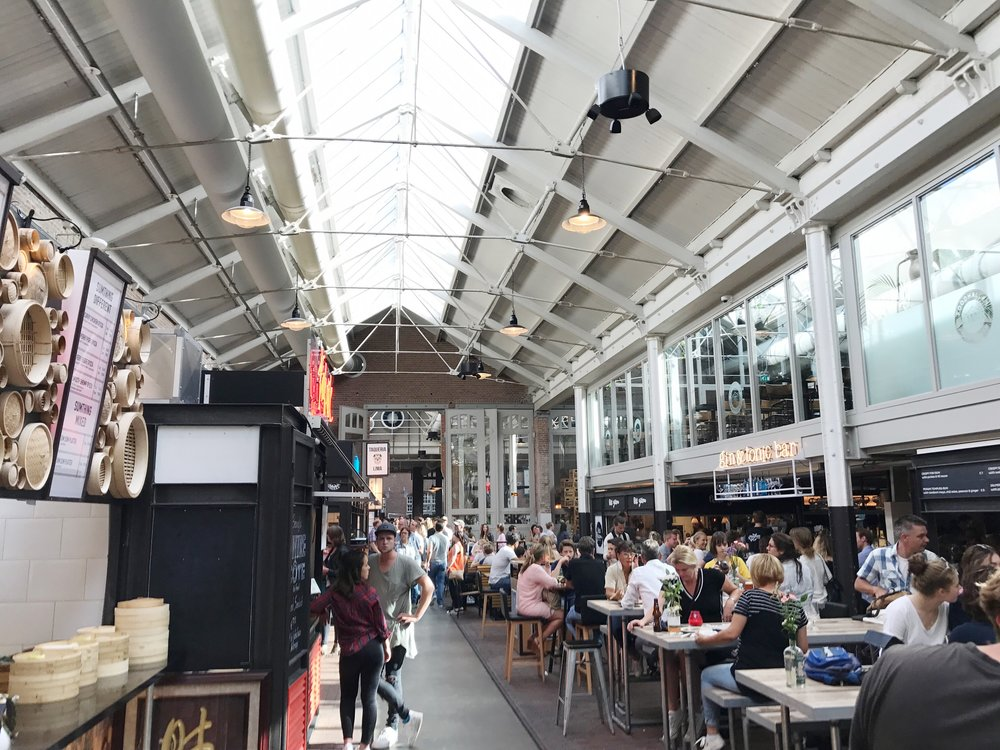 Foodhallen is a super trendy food hall in an old train depot.