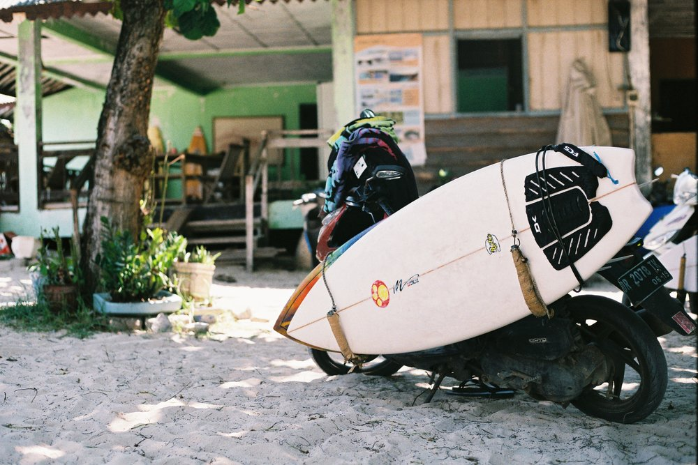 We spent most of our time burning around on this moped whilst in South Lombok last year. So much fun! We had one day where we got caught in torrential rain and took the wrong turn to get to this beach to go surfing. We ended up going through all these locals properties to get there. We got bogged, skidded a lot, enhanced our adrenaline levels and arrived at the beach for a sweet session surfing with the help of some locals. Good times! Shot on a Canon 35mm film camera.