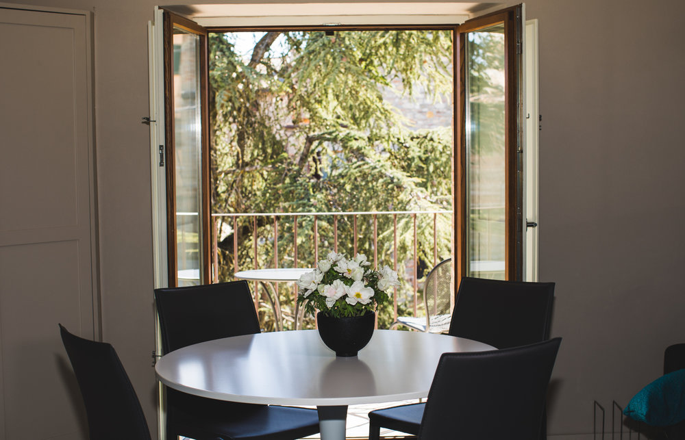 the-apartments-montone-dining-table-and-balcony-HD.jpg