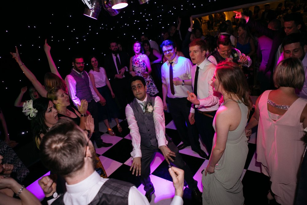 Guests dancing on the dance floor with the wedding band