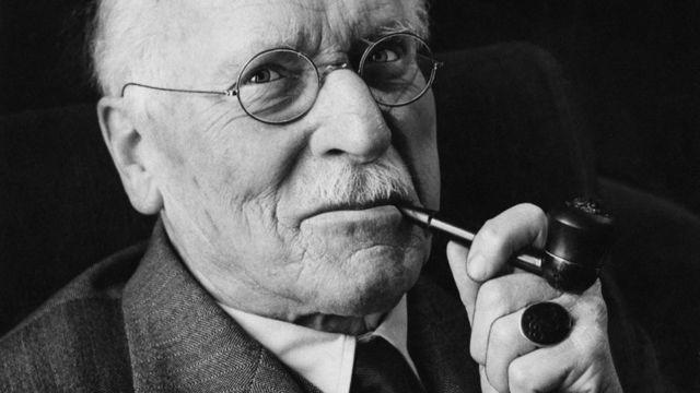 Carl Jung smoking a pipe.