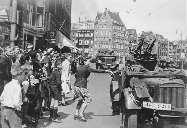 Dutch people celebrating the arrival of the Nazis in Amsterdam, May 1940