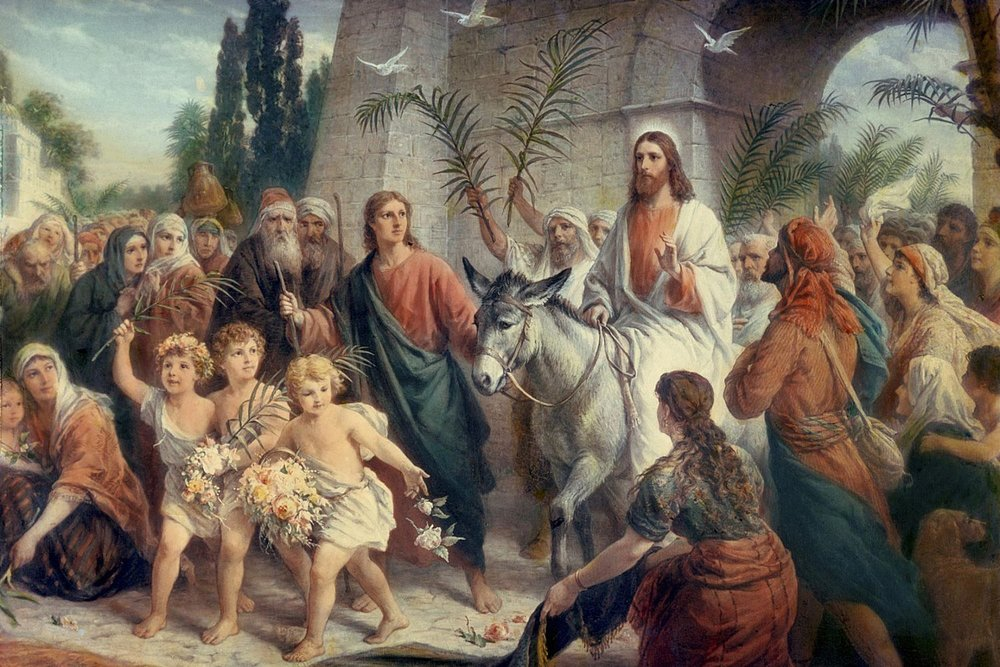 Jesus entering Jerusalem.