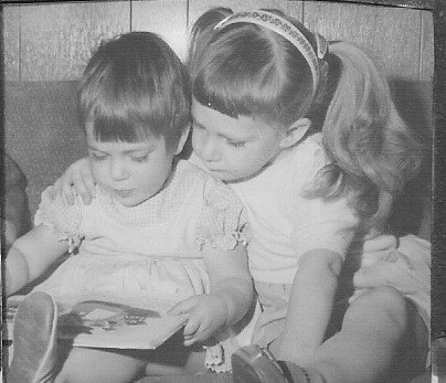 sisters and books Leigh-Ann reading with her Sista.jpg