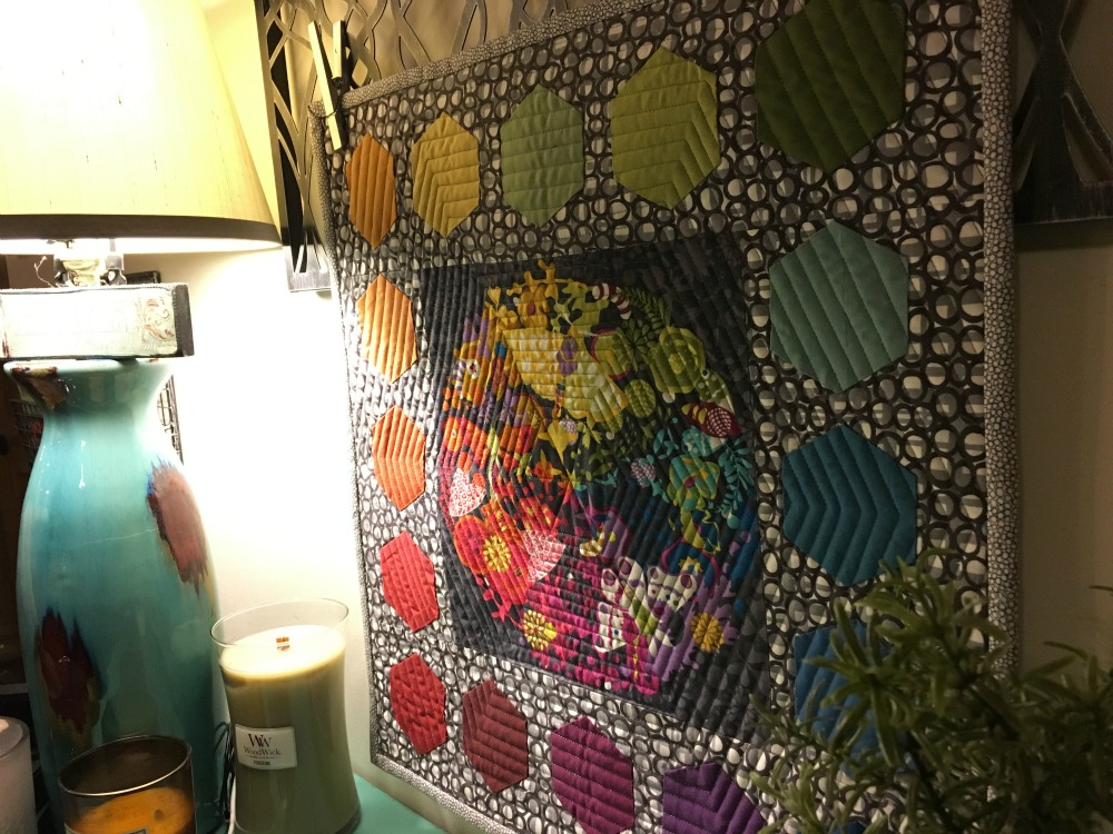 Alison Glass' Ex Libris Fabric is center stage for this Hexagon Rainbow Quilt.