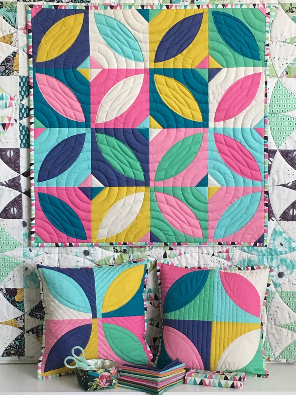 Orange Blossom Quilt, made by Maxie; pillows by  Sarah Overton . Pattern by  Plum Easy Patterns .