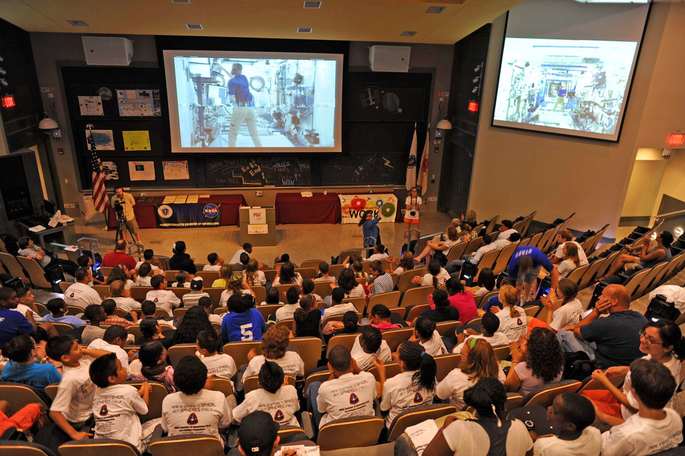 ten SPHERES Zero Robotics student teams watching two views of the ISS competition live from MIT. Image courtesy of John Tylko from the Aurora Flight Science Corporation.