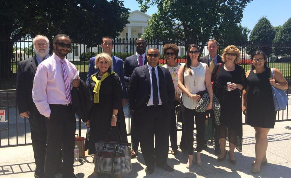 City Network representatives from Allentown, PA; Philadelphia, PA; Baton Rouge, LA; Research Triangle Park, NC; Chicago, IL; San Francisco, CA; Indianapolis, IN; Wichita, KS; Bosten, MA pose outside the White House.