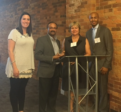Maggie Cline poses with Mathew Palakal and Vicki Daugherty of IUPUI, as well as with Ahmed Young from the Mayor's office.