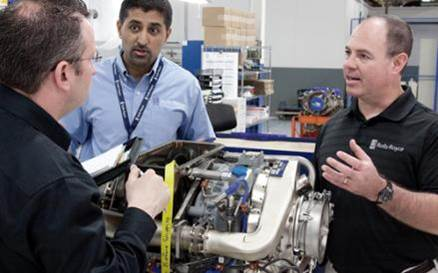 Rolls-Royce engineers collaborate over an M250 engine.