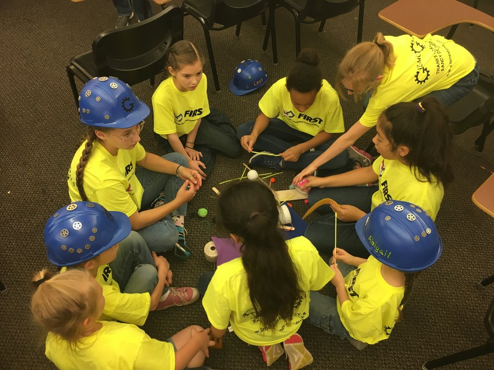 A team of girls works together to design their prosthetic concept for Ruby Roo.