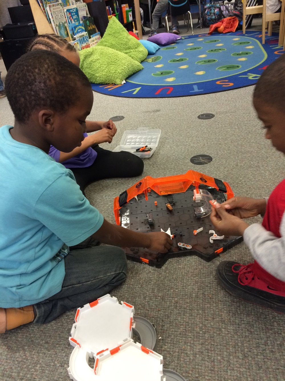 Students from Spring Mill Elementary School play with their HexBug kits.