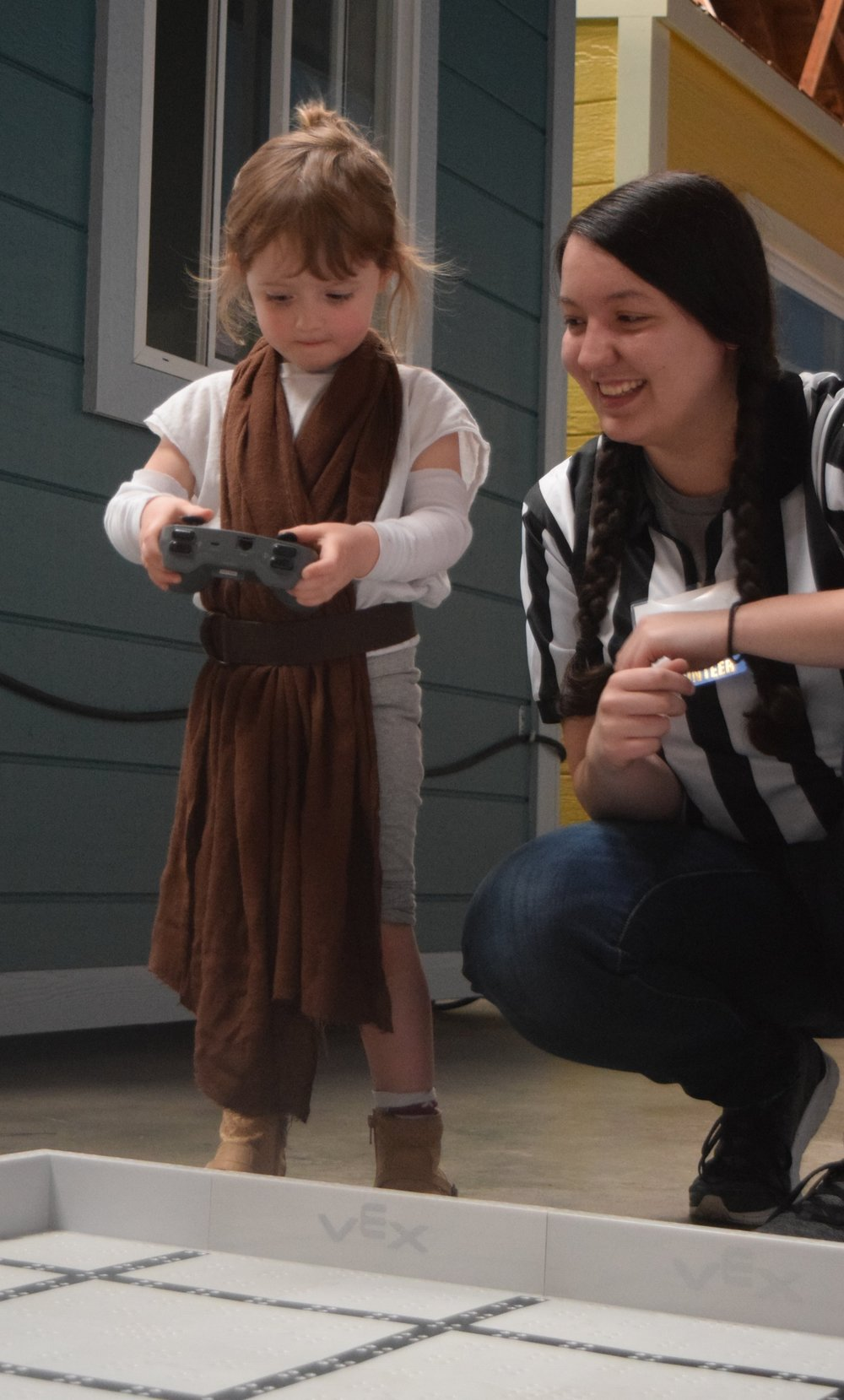 "A miniature ""Rey"" taking part in our Droid Driving Competition"