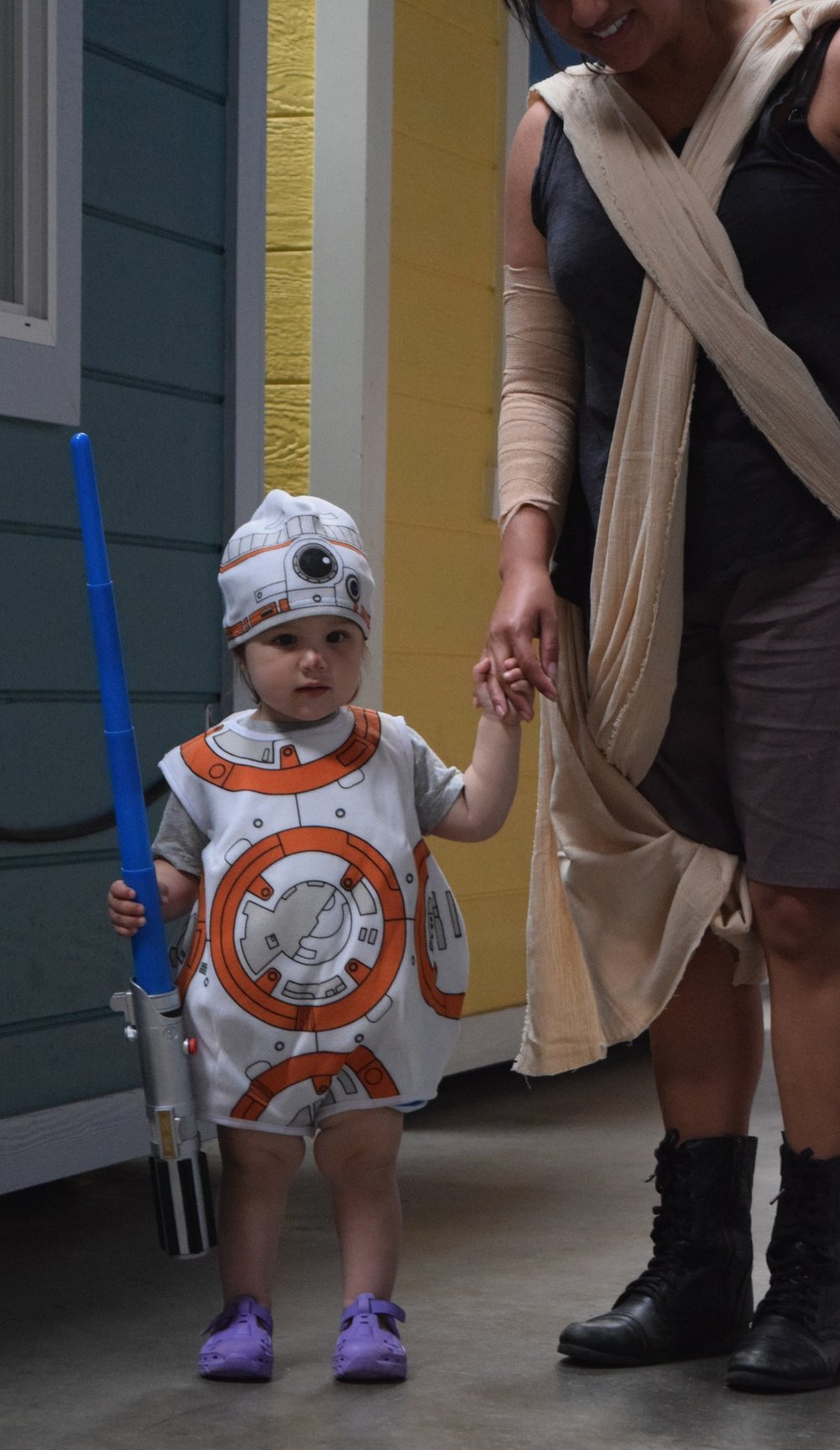 A tiny BB8 wielding a lightsaber