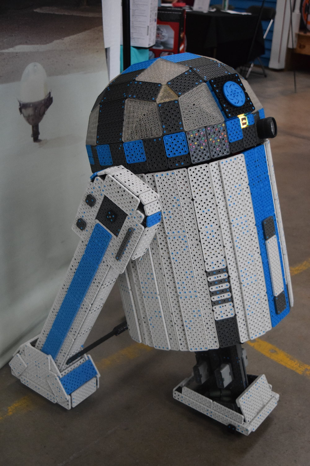 A life-sized R2D2 built of LEGOs drove around the event greeting guests