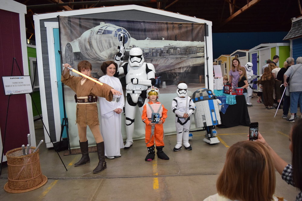 Guests getting their pictures taken with members of Star Wars Indiana