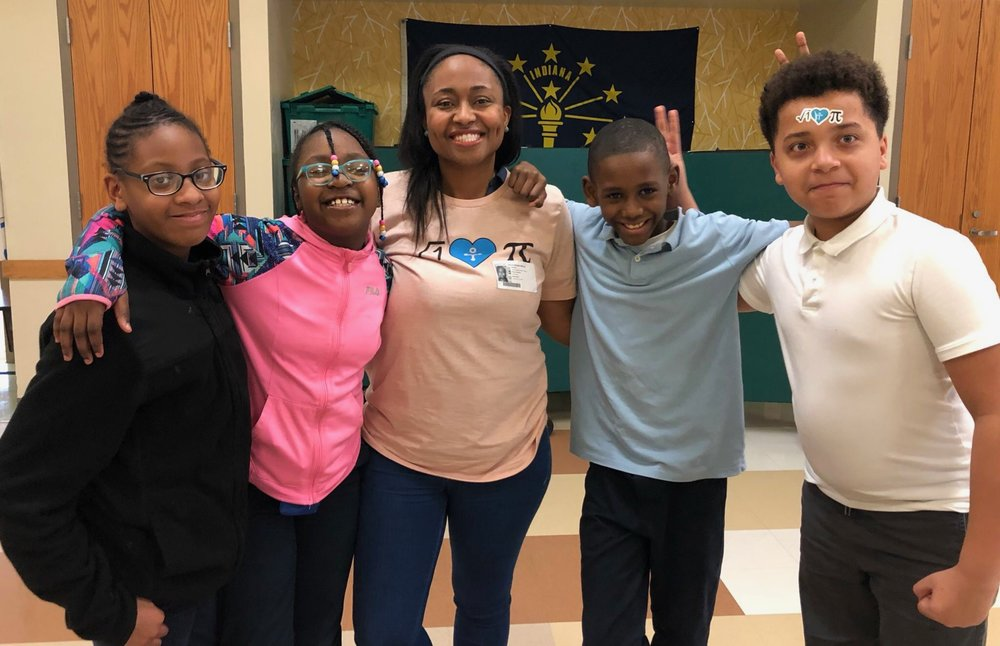 4th graders from New Augusta Public Academy South with a volunteer from First Internet Bank.