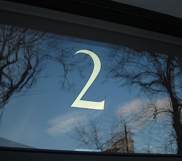 Hand crafted mirror gold leaf house numeral for Kensington, London.  #GoldLeaf #GoldGilding #SignWriting #SignPainting