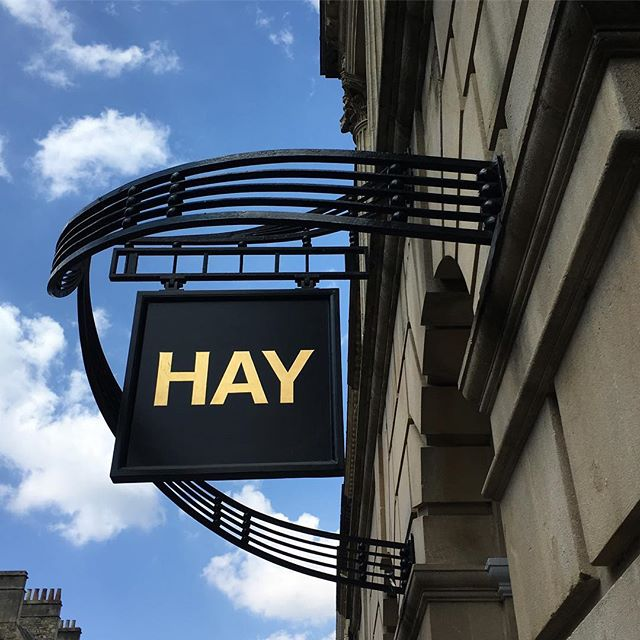 Gold leaf hanging sign for Swedish design shop HAY on Milsom St, Bath. Gilded with 23ct italian gold  #GoldLeaf #GoldGilding #MilsomStreet #SwedishDesign #Bath #23carot #BlockLettering #TraditionalSignWriter #SignPainter #SignPainting