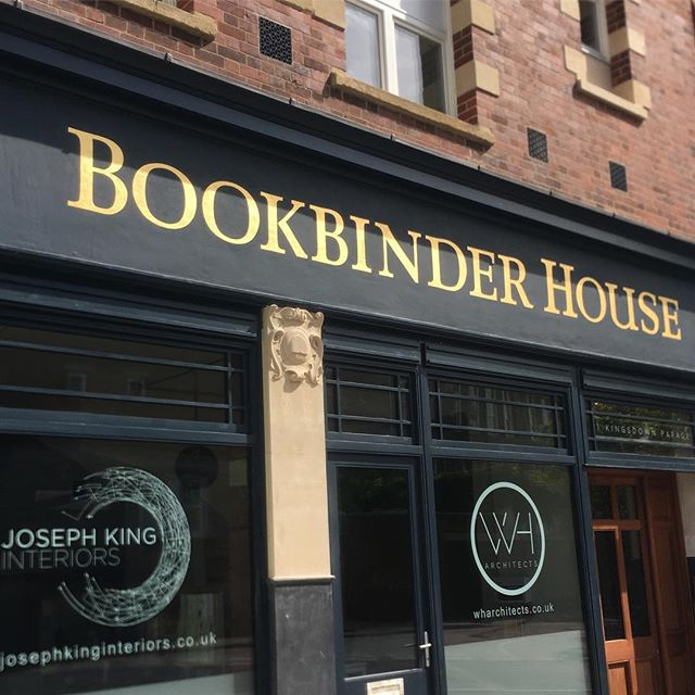 Hand painted gold leaf letters for Bookbinder House, Bristol. Drawn up in situ with a small crowd of architects.... no pressure.  23ct Orange Italian Gold leaf for this one. We gave the letters some old school guts and chunky serifs for this beautiful big old building.  Home to @josephkinginteriors and @whabristol  #traditional #signwriting #goldleaf