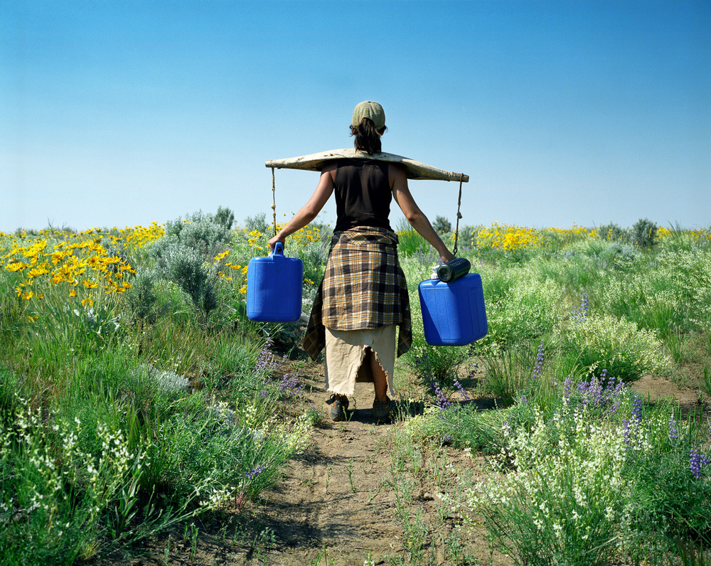 Carrying Water  © Adrain Chesser