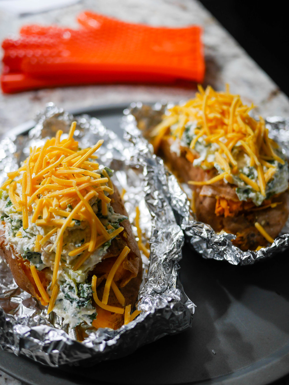 Load up the pre-baked sweet potatoes and top with shredded cheddar cheese. 15 more minutes and they're ready to enjoy!