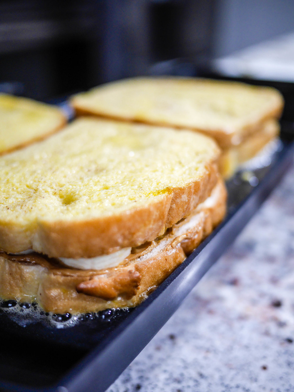 Preheat your griddle to 325 degrees and melt a bit of butter on top to keep toast from sticking.
