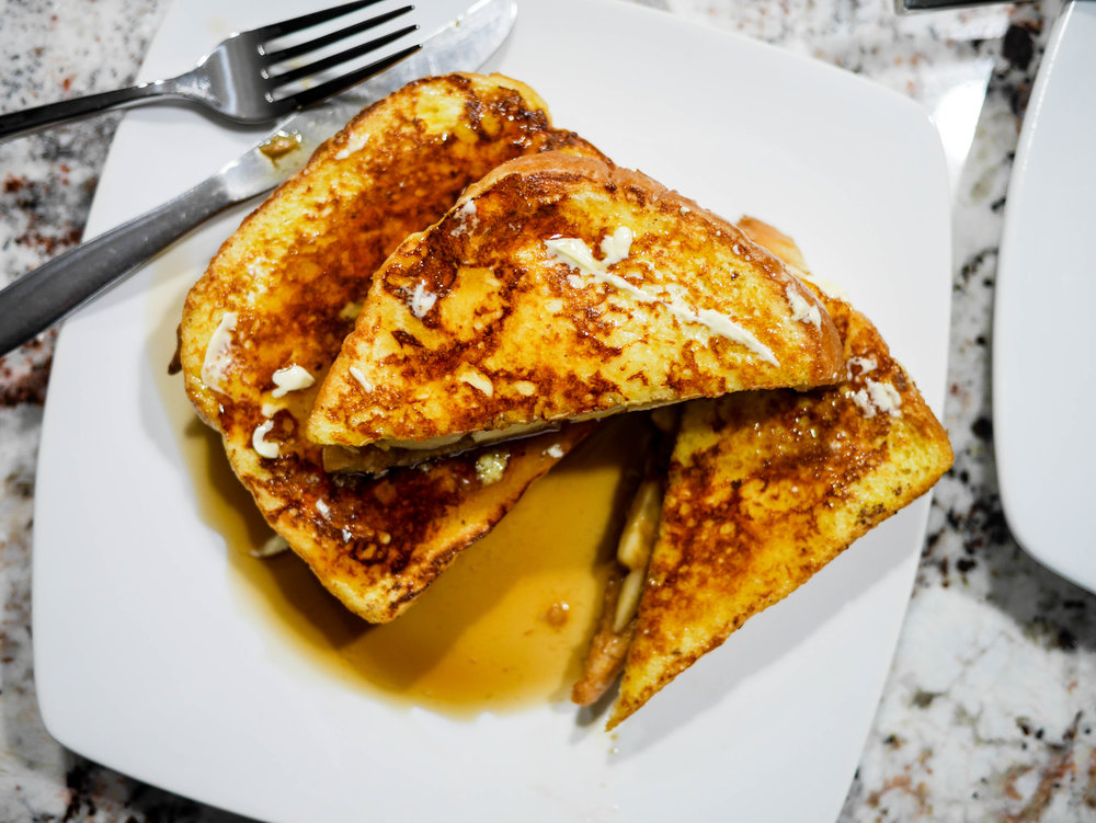 Butter french toast sandwiches right after removing from the griddle and top with your favorite topping - syrup, whipped cream, chocolate, nutella, the sky's the limit!