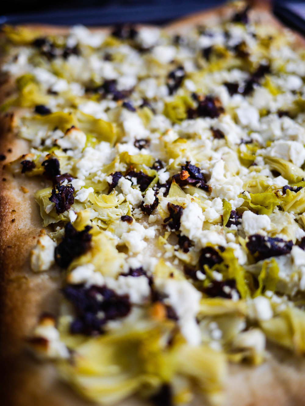 Artichokes, pepperochinis and sun-dried tomatoes make this the perfect pizza for a Meatless Monday!