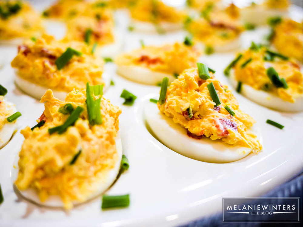 Topped with chopped chives and sliced jalapenos, these pimento cheese deviled eggs are packed full of flavor.