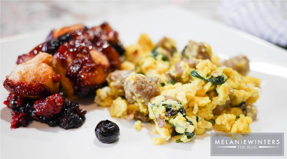 Sweet cream cheese stuffed mixed berry monkey bread is the perfect accompaniment to a savory sausage and spinach scramble.