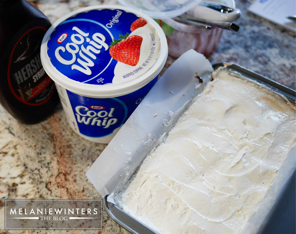 Make your own whipped topping or take a shortcut with Cool Whip, and you're almost done assembling this delicious Strawberry Cheesecake Ice Cream Cake.