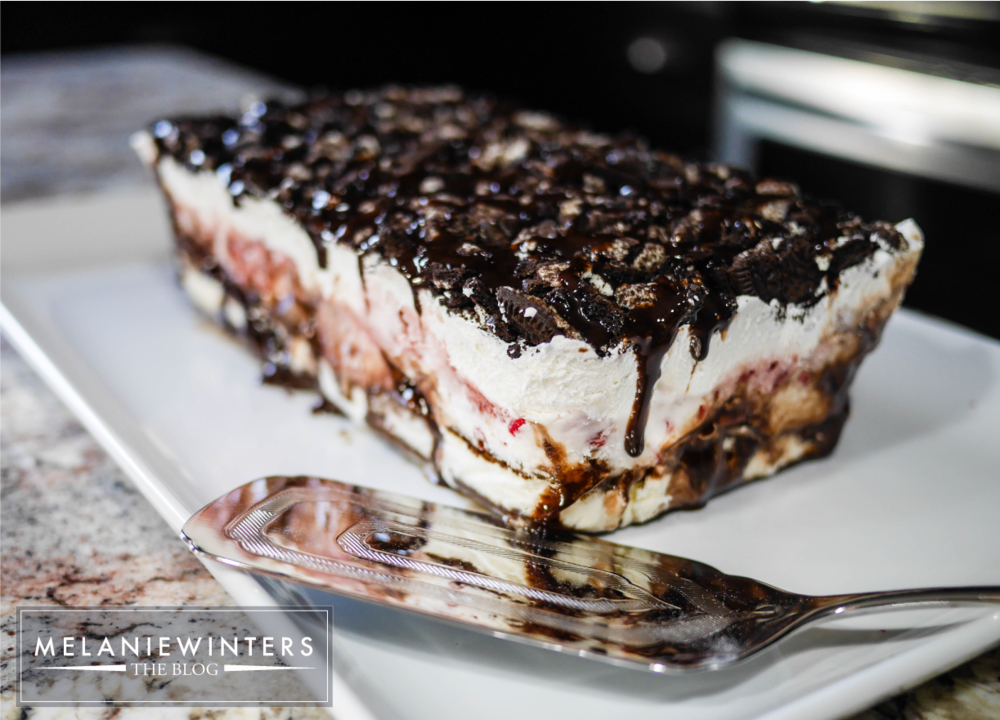 Layers of frozen deliciousness with drizzles of Hershey's syrup make this a beautiful but simple ice cream cake - perfect for any summer occasion.