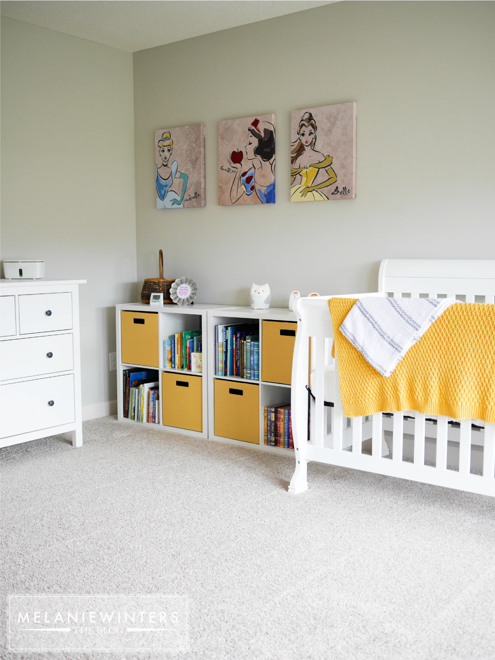 Crisp whites with a pop of yellow make this a nursery everyone enjoys spending time in.