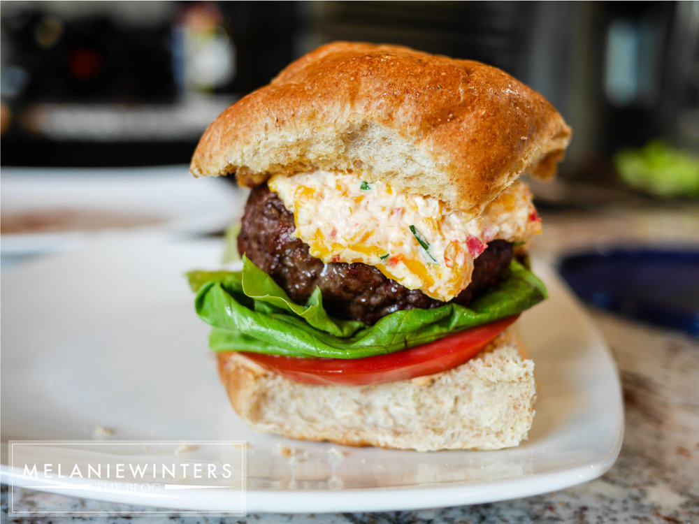 A couple fresh toppings let the pimento cheese be the star of the show on this pimento cheeseburger.