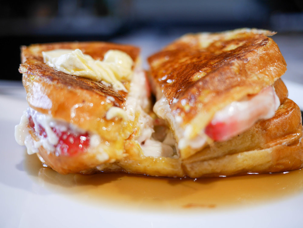 Stuffed with cheesecake filling and sliced strawberries, this is a restaurant worthy french toast recipe that's soon to be a staple for your weekend brunch.
