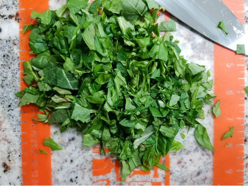 Stir baby greens into soup.