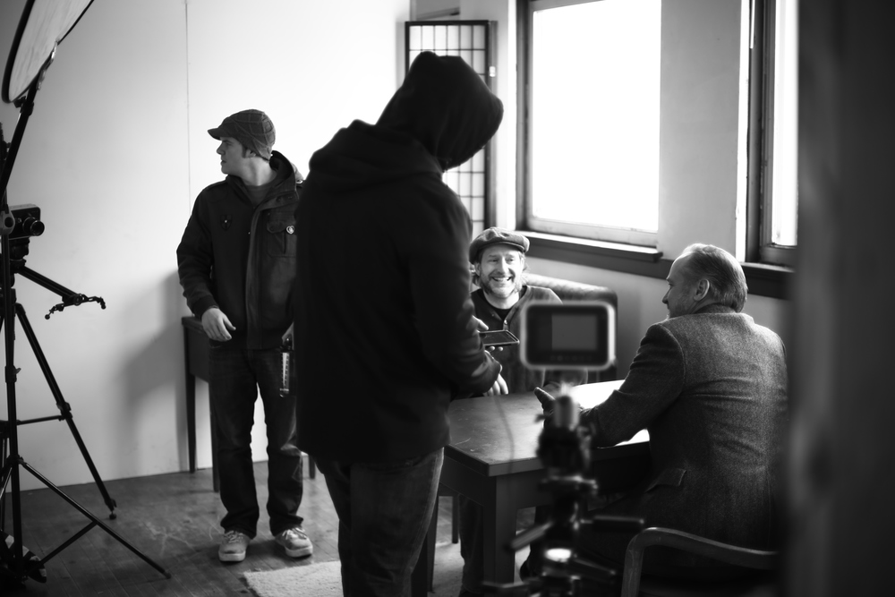 Director Roger Scholz talks with lead, Mark Boyd, during Sunday's dialogue heavy shoot. Not pictured, the real mvp(115,00 btu kerosene heater.).