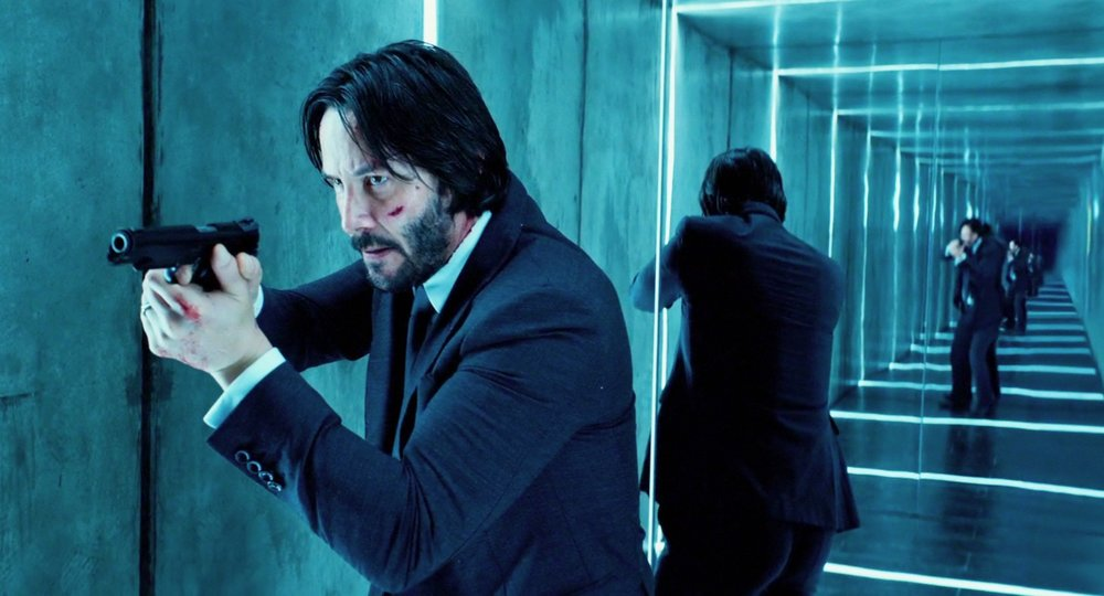 A scene from John Wick 2, a series that successfully employs color to reinforce narrative. Characters within the film are often highlighted with a specific hue that compliments their intent.