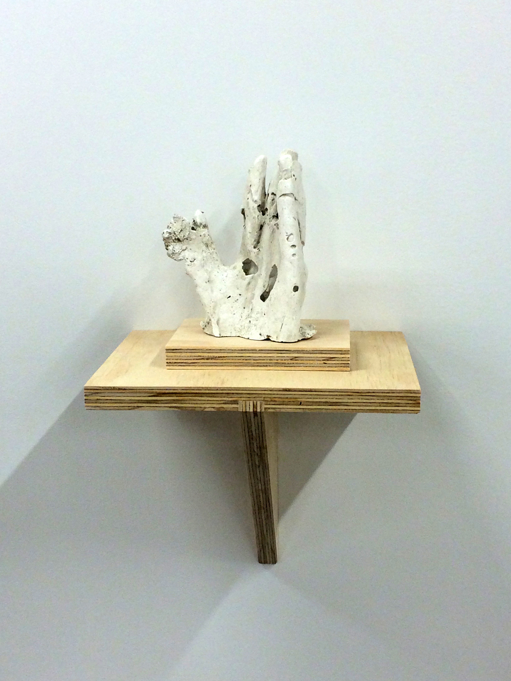 "Hand No.1, 2015. Plaster and plywood, 18x8.5x9""."