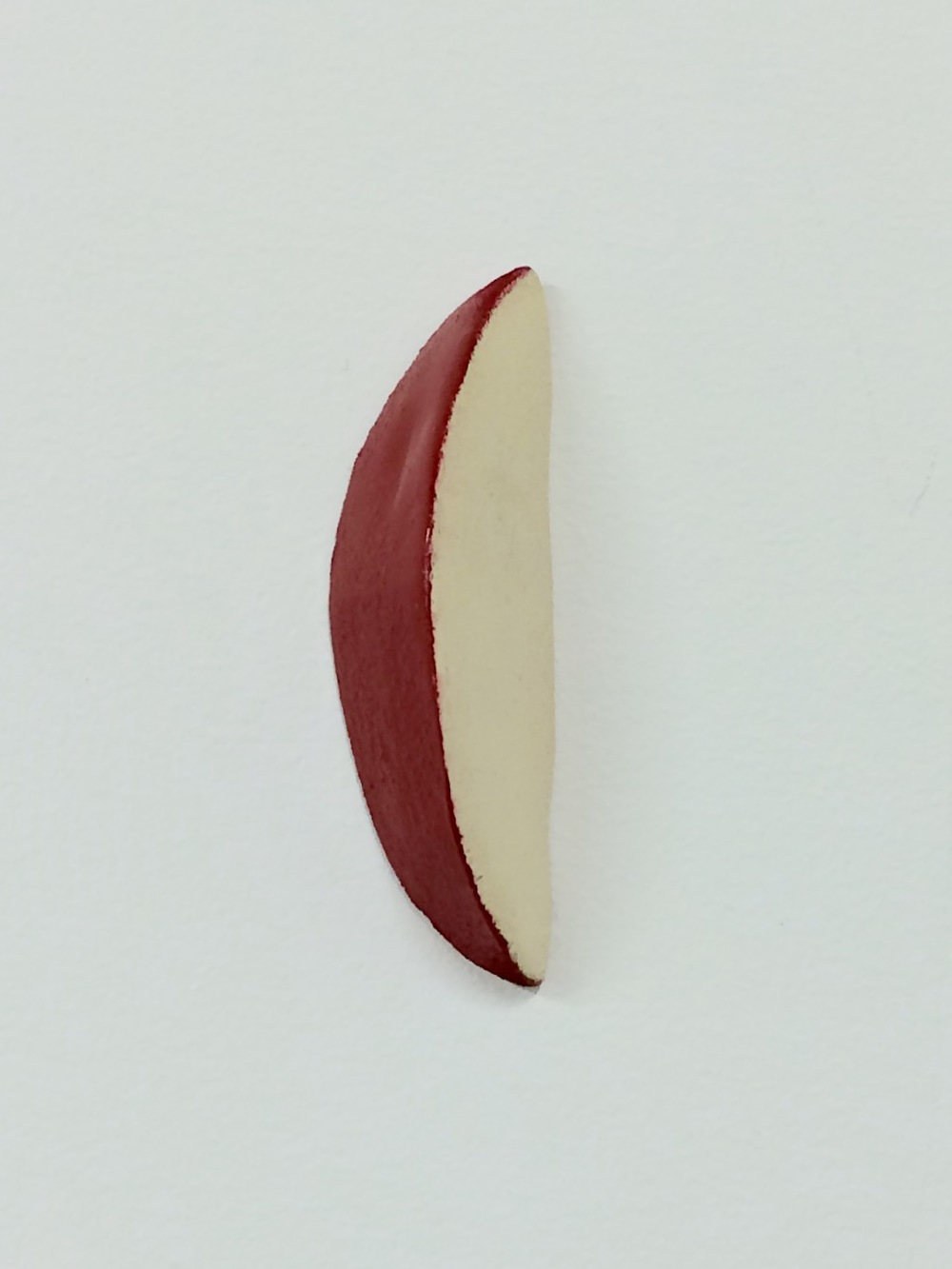 Untitled (apple slice), 2016. Wood, paint, 2.75 x 1 x 1 inches (sold)