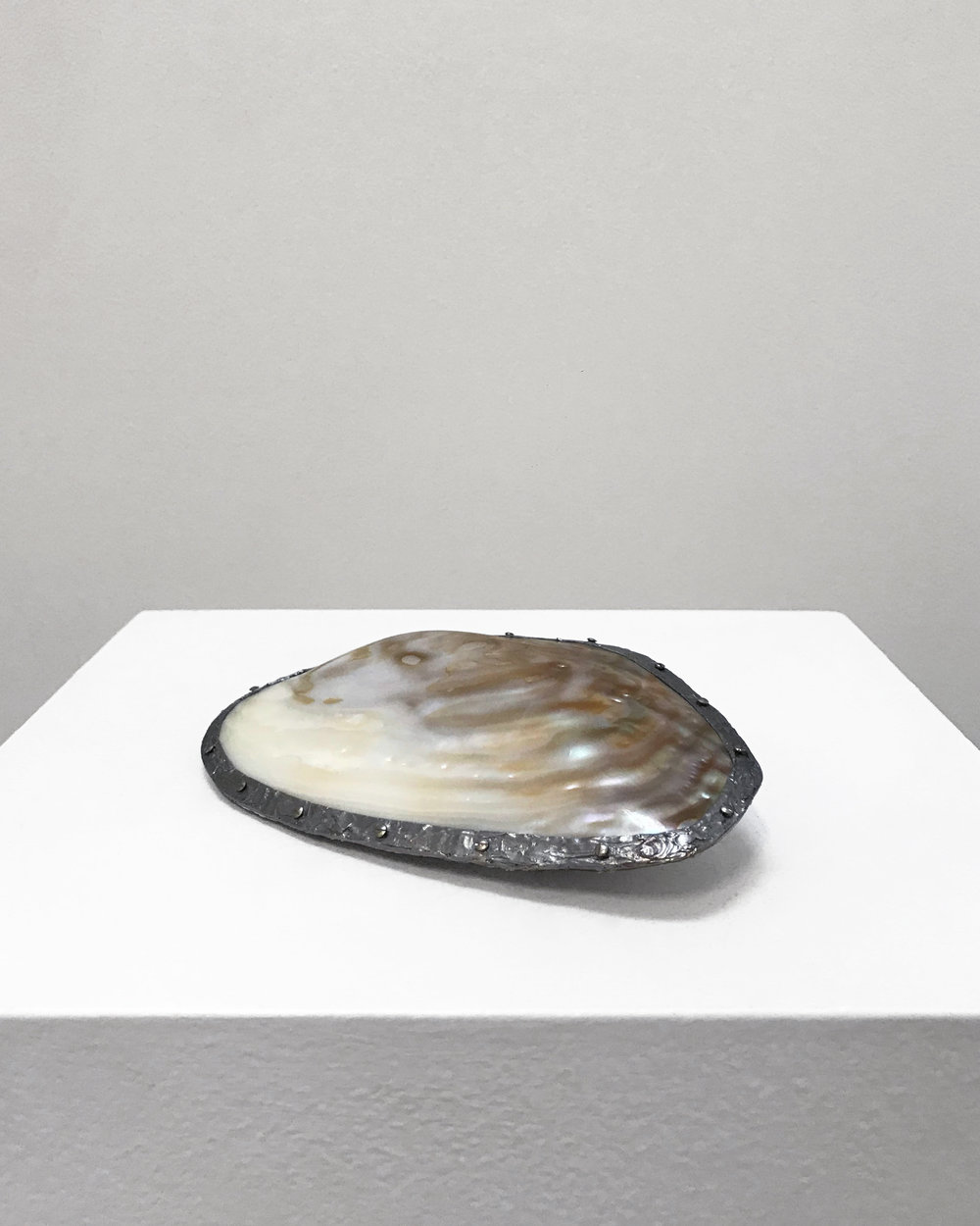 Bea Fremderman, Untitled, 2018. polished mother of pearl cebu clam, solder, screws, 7 x 3.5 x 2 inches