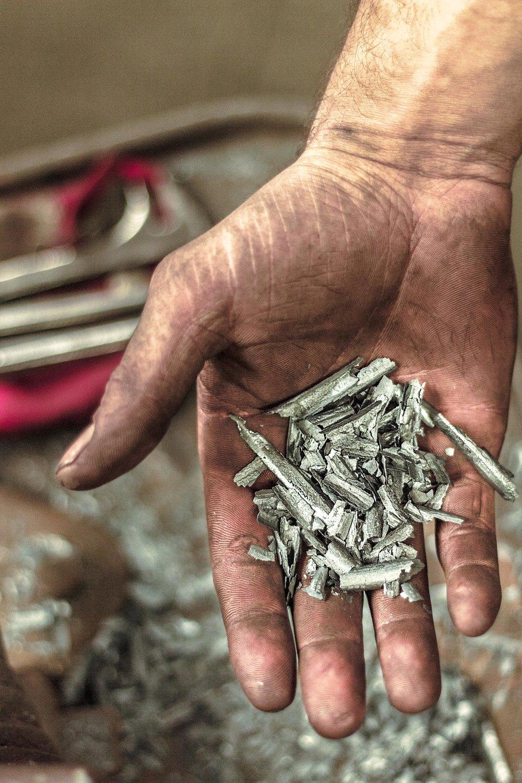Shards of metal in hand .jpg