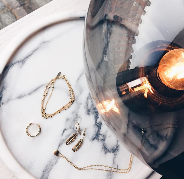 Delicate gold jewellery matches perfectly with Bowl Table Lamp / Photo by Sirin Copenhagen