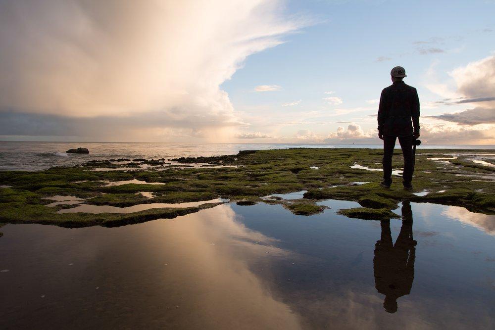 Man standing beside the sea.